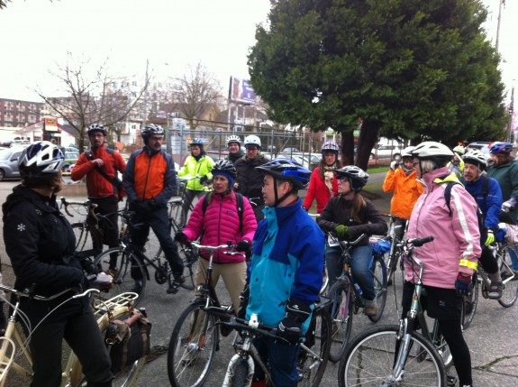 Chang is stopped with a bike in a group of people on bikes.