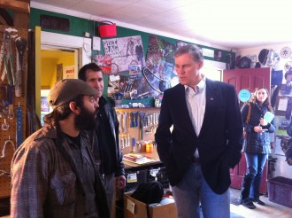 Then-candidate Jay Inslee visits Bike Works in 2012