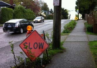 Community-installed signs requesting drivers to slow down and watch for pedestrians
