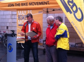 At Bike to Work Day rally, Mike O'Brien reads Council document praising the work of Cascade's Chuck Ayers