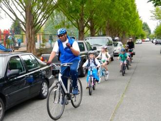 Loyal Heights principal Wayne Floyd leads a bike train