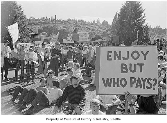 Photo from MOHAI: Rally Against the Burke Gilman Trail, Seattle, 1971 Signs in image: Do the Hungry and Needy Really Want [...] Million Trail. [...] Woods [...] in My Yard. Not More Taxes. Who's Paying for This $10 Million Dream? We Don't Want It. Burke Gilman Trail. Enjoy But Who Pays? Who Pays for Upkeep. Photographer: Tom Barlet Image Date: 1971 Image Number:1986.5.55062.1 - See more at: http://www.mohai.org/explore/blog/item/2067-rally-against-the-burke-gilman-trail-seattle-1971#sthash.3mRtlXsn.dpuf
