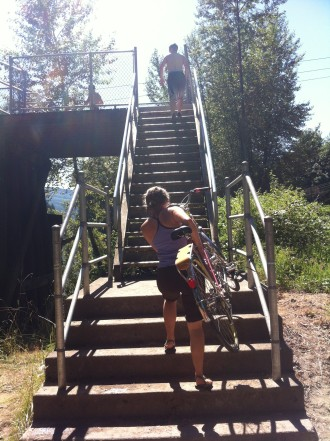 People wanting to take the trail into North Bend have to carry their bikes up the stairs, which were set on fire.