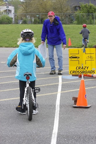 Teaching biking skills at a West Woodland Elementary bike rodeo (photo courtesy Polly Freeman)