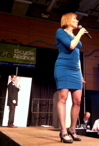 Barb Chamberlain announces the name change at the 2013 auction