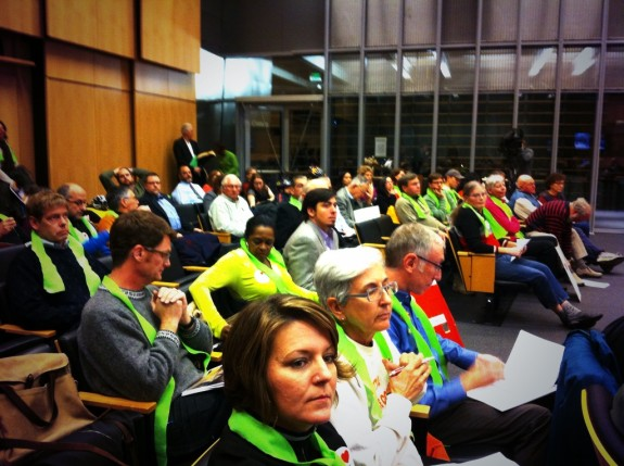 Seattle Neighborhood Greenways supporters donned green scarves to show their support for the plan