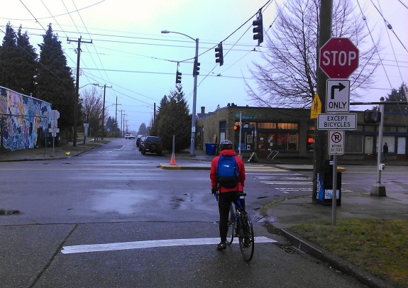 People on bikes can choose to either cross in the street at Beacon Ave S or use the pedestrian signal
