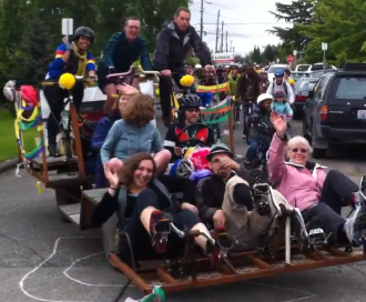 This remains my favorite photo of Tom Rasmussen, pedaling a crazy Stevens-designed pedal-powered parade float with Sally Bagshaw