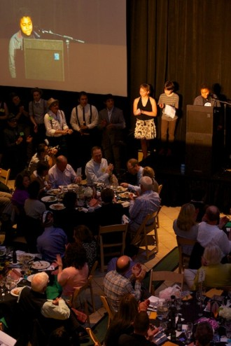 Bike Works youth tell the auction crowd how Bike Works has impacted their lives. Photo by Ken Yasuhara