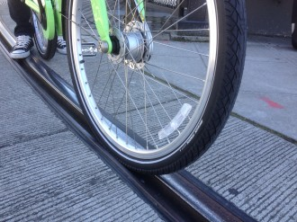 Fatter tires (like the ones on Pronto bikes) are less likely to get stuck in streetcar tracks. But tracks can still be dangerously slick when wet.