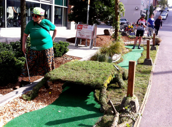 Cathy Tuttle of Seattle Neighborhood Greenways plays putt-putt golf in South Lake Union. PARK(ing) Day 2013