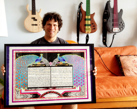 Brandon Blake holds the ketubah he made joining him with his wife Sabrina. Blake's brain injury has not stopped him from continuing his art.
