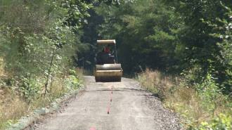 Crews work to pack down the interim gravel Cross Kirkland Corridor Trail to make it ready for biking and walking. Image from Kirkland
