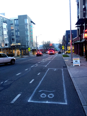 Spray paint marks prep Roosevelt for a pilot protected bike lanes to be installed soon.