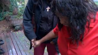 Myurie Ausler gets help walking. Screenshot from King 5 (click to watch)