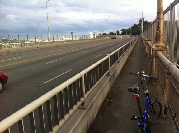 Biking on the Aurora Bridge. Not great, but not nearly as terrible as the Ballard Bridge.