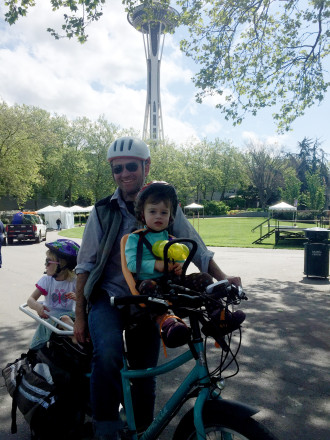 WA Bikes' Blake Trask biked his kids to Pacific Science Center, saying he couldn't have done that without the new lanes on Mercer.