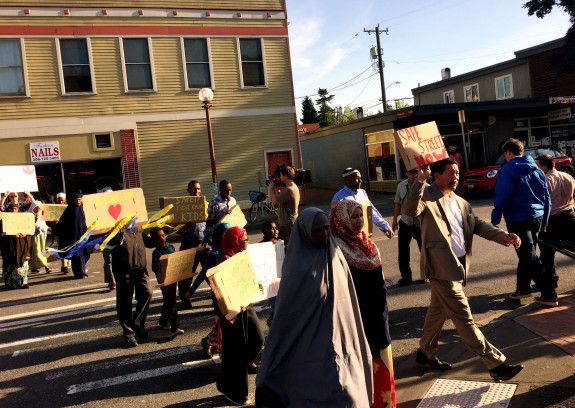 """Councilmember Harrell holds a sign reading, """"Safe Streets Now"""""""