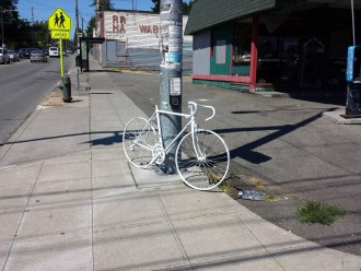 Photo of the ghost bike memorial at NE 65th Street and 15th Ave NE, from ghostbikeguy