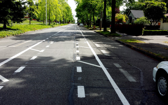 The unprotected (double-buffered) lane on the west side of College Way N, with lots of driveways.