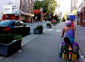 Vancouver bike lanes use planter boxes (and usually curbs) to separate bike lanes downtown.