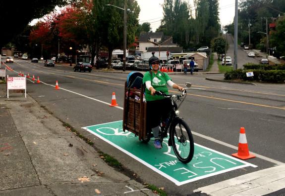 Rainier Ave bike lane demonstration organizer and bad ass mom Shirley Savel. Read her account of making this lane happen on her blog.