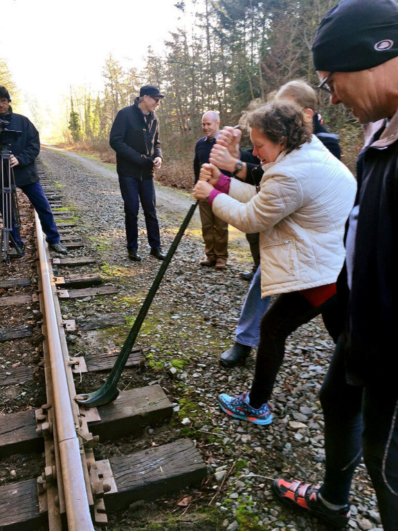 Shelly Bowman pulls out a rail spike during the ceremony.
