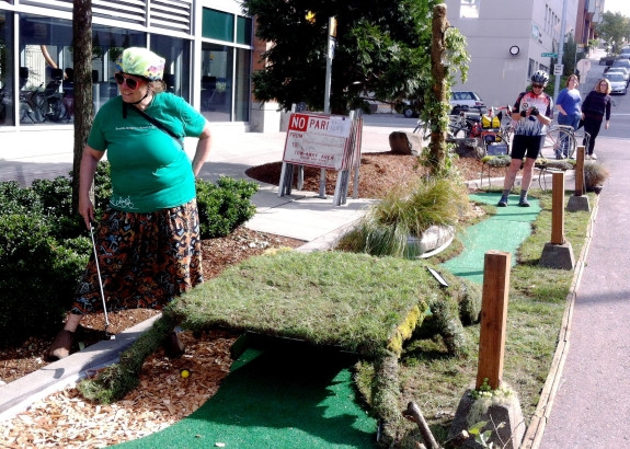 Tuttle rocks a game of post-car mini-golf during Park(ing) Day 2013
