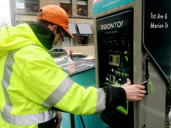 Pronto's Lead Technician Grant Kahl inspects a kiosk.