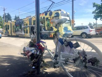 Friends and family of Desiree McCloud painted her bike white and decorated it with notes, flowers and Magic cards. Unlike most ghost bikes, this one is the bike she was riding when she crashed.
