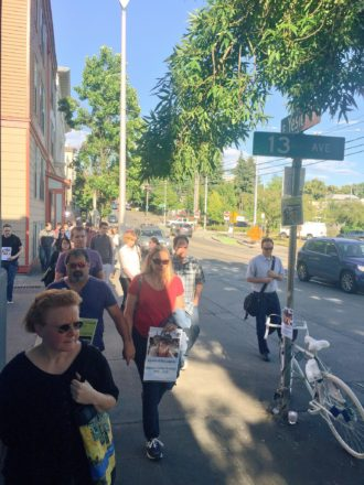 Friends, family and community members walk in honor of McCloud. Her ghost bike sits at 13th and Yesler.