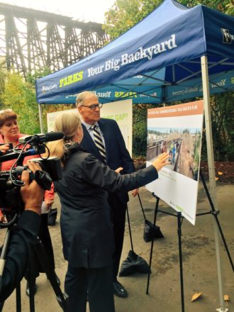 Governor Inslee checks out a concept for a completed trail on the trestle.