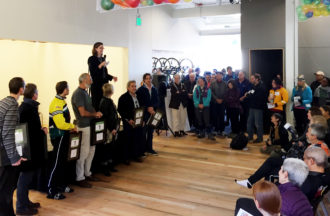 Elizabeth Kiker speaks at the opening of the Cascade Bicycling Center