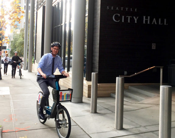 Councilmember Rob Johnson takes the Bewegen bike for a test ride