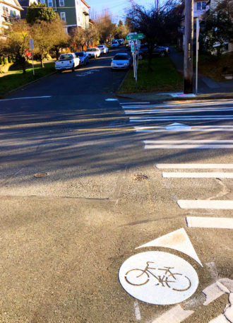 One of the relatively few 2016 bike plan projects completed on schedule, the underwhelming Columbia St neighborhood greenway is not likely to have much of an impact on bike mobility in Seattle. Pictured: The route's odd crosswalk swerve at 14th Ave.