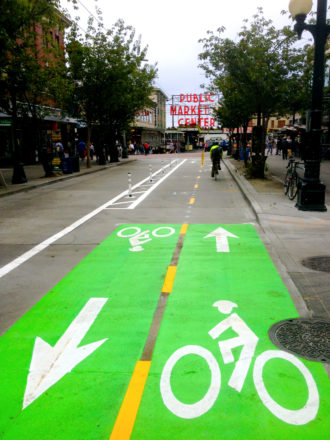 One option that should be on the table: Simply extending this one-block bike lane on Pike through downtown.
