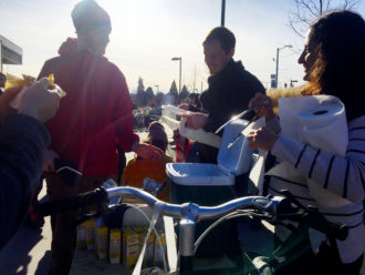 Anna helps serve tamales out of the family cargo bike.