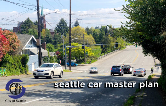 """Photo of N 50th Street with the words """"Seattle Car Master Plan"""" on it."""