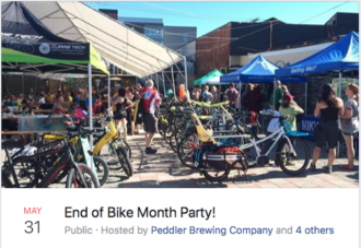 Photo of people, bikes and exhibition tents in the Peddler Brewing yard.