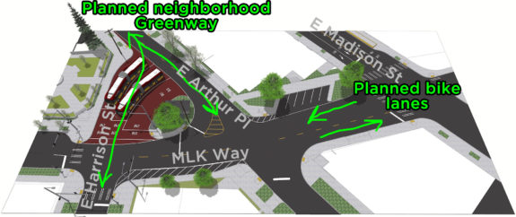 Design rendering of the MLK/East Harrison Street/East Arthur Place intersection, which includes a new bus layover space. I marked the planned neighborhood greenway and bike lane routes that are missing.