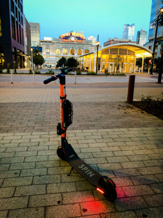 Photo of a Spin scooter in front of Denver's Union Station.