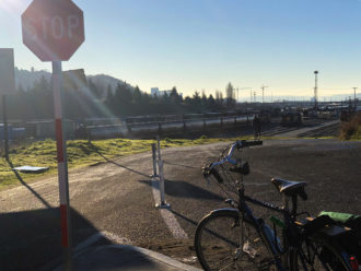 Photo of a bike next to a stop sign on a street in Interbay.