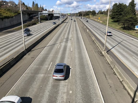 Photo of a mostly empty I-5 in the middle of the day.