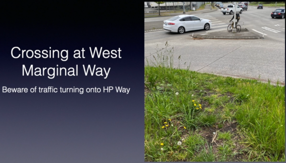Screenshot from the video. Image shows a gap between the end of the path and the crosswalk. Text: Crossing at West Marginal Way. Beware fo traffic turning onto HP Way.