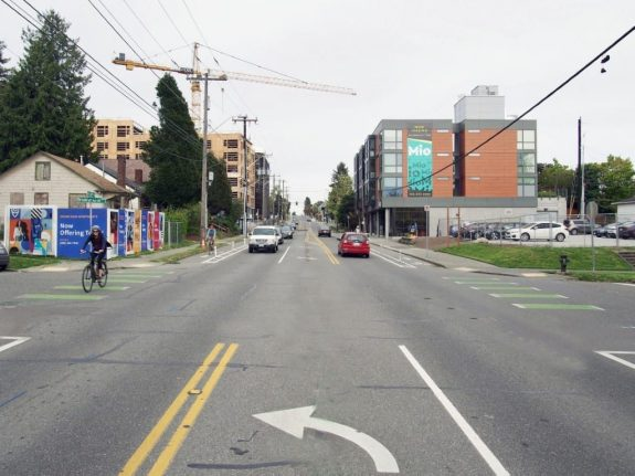 Photo after the changes with a center turn lane and bike lanes.