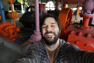 Photo of Tom Fucoloro with Gas Works Park machinery in the background.