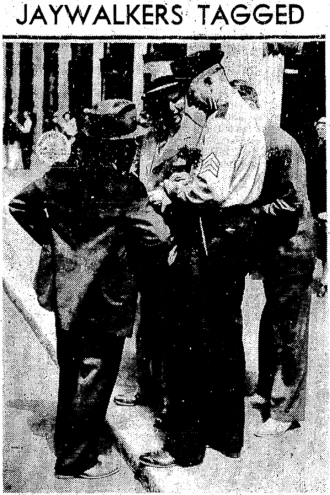 An officer stopping men for jaywalking, from a 1939 newspaper.