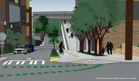 One way street with two-way PBL and sidewalk separated by trees in front of a ramp to the overpass