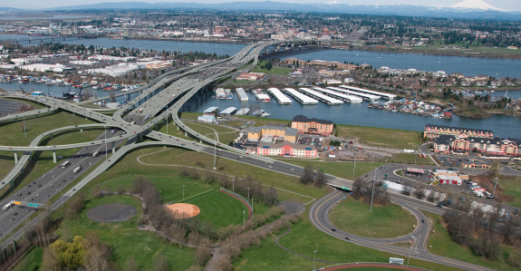 Huge freeway bridge crossing an island with interchanges and ramps everywhere