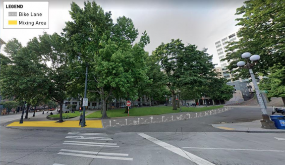 """Bike lane coming from 4th ave on right side turns into yellow """"mixing area"""" on sidewalk at 3rd and Yesler"""